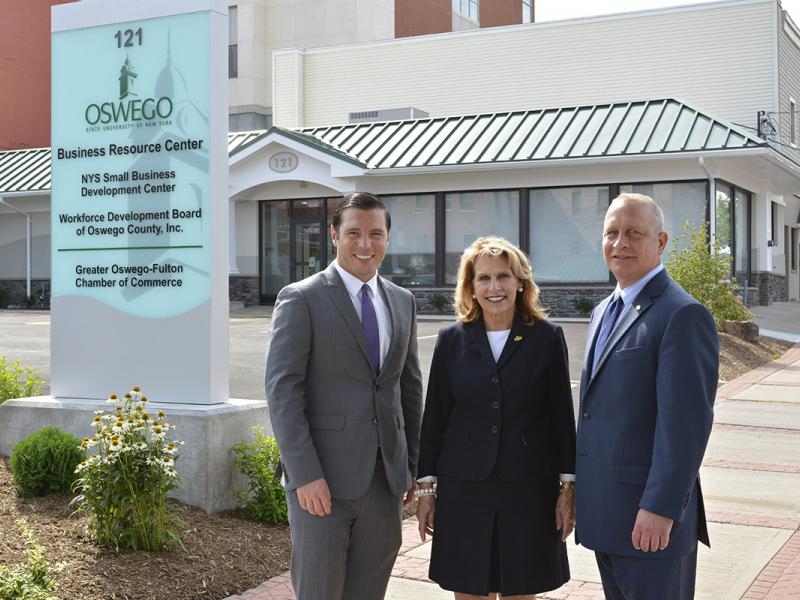 Oswego Mayor William J. Barlow Jr., SUNY Oswego President Deborah F. Stanley and Pathfinder Bank President Thomas W. Schneider, fronting the college's new Business Resource Center in Oswego