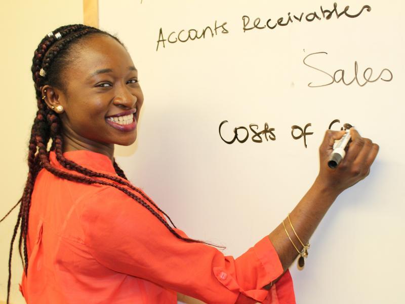 Charlene Assam writing on board