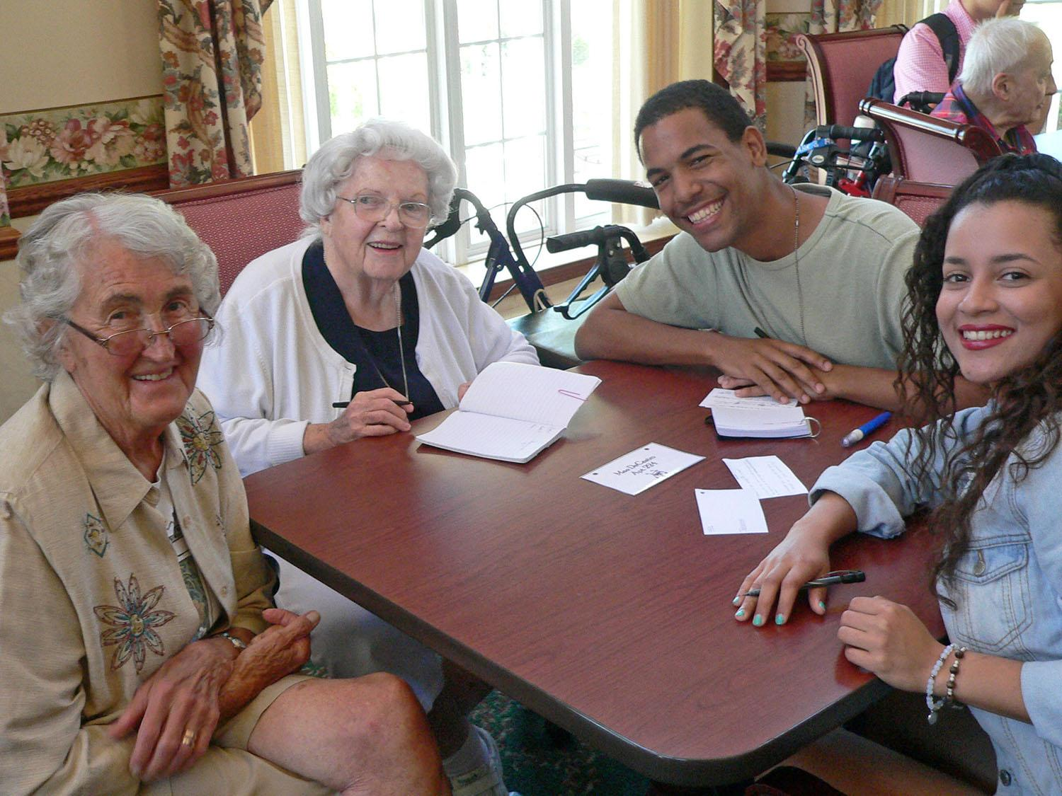 Participants in SUNY Oswego's summer English Immersion Program made a visit to Bishop's Commons in Oswego for a chance to practice their language skills while enjoying an afternoon of getting to know local seniors.