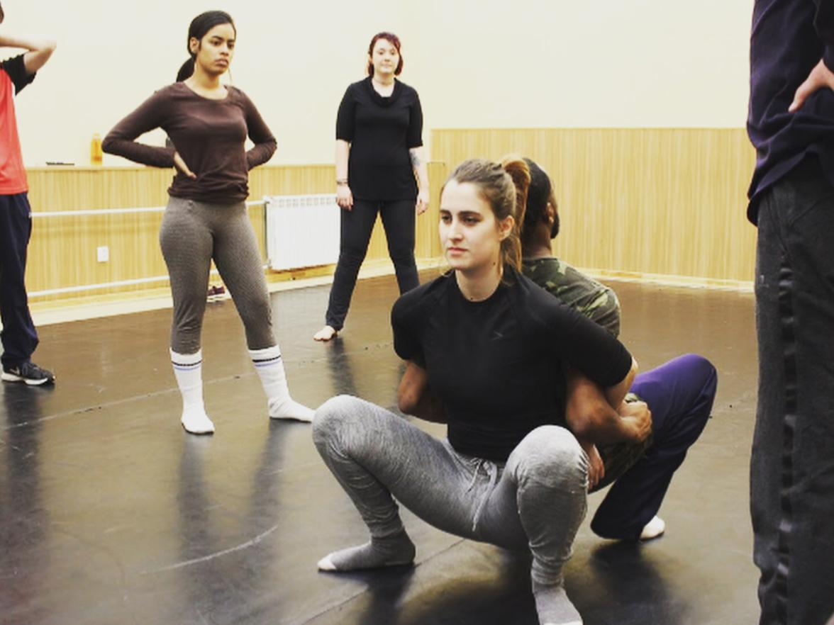 Students in a movement class learn about trust with fellow actors
