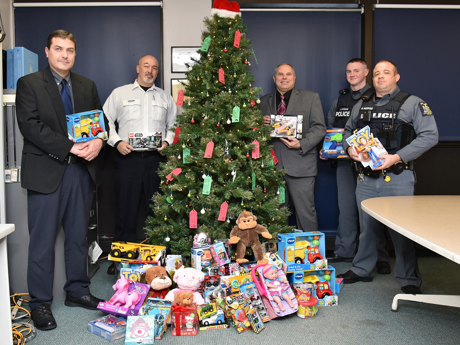 University Police with toys collected through dodgeball tournament