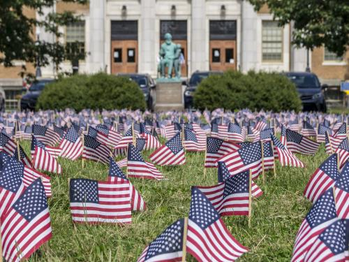 Students, veterans, first responders, faculty, staff, administrators and community members planted 2,996 flags on the front lawn of Sheldon Hall to remember every person killed in the 9/11 terrorist attacks