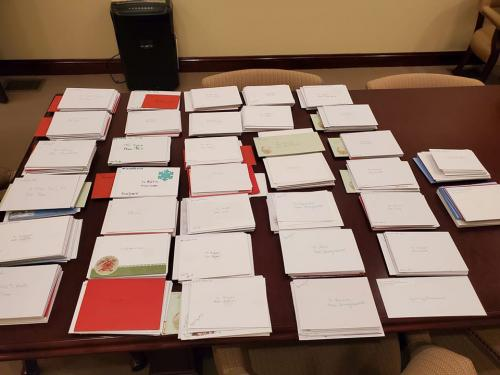 A table full of cards for those impacted by mass shootings