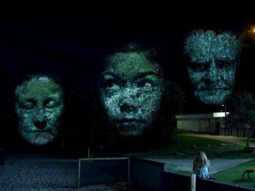 Project visual art of three faces by Craig Walsh at a previous installation in Australia