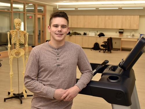Student Maxim Kutepov in new laboratory of department of health promotion and wellness in Wilber Hall