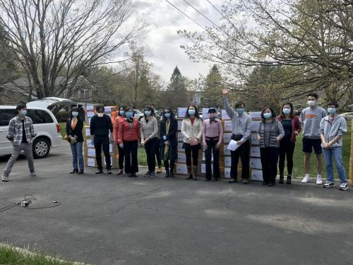 Members of the Chinese-American community with collected PPE which they donated across Central New York