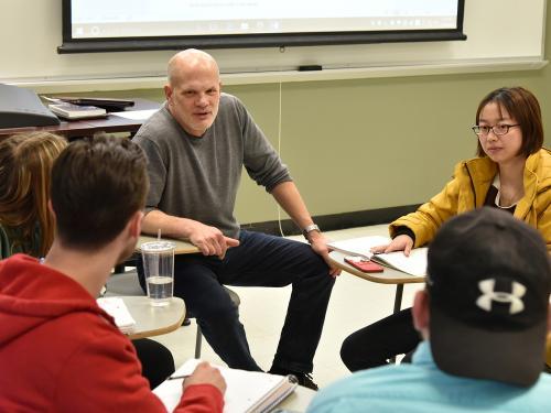 Economics professor David Andrews having class discussion