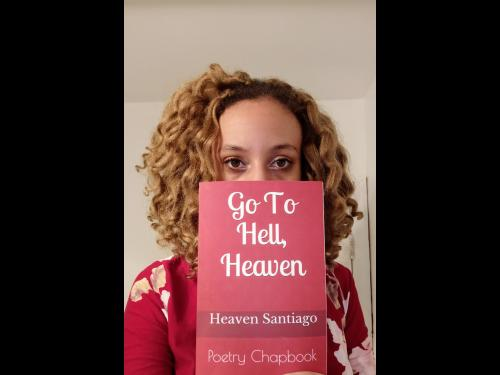Heaven Santiago with her book of poetry, Go To Hell, Heaven