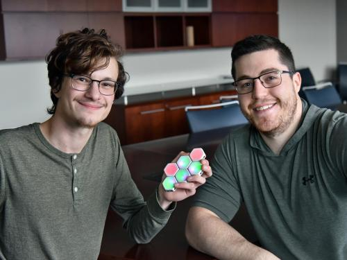 Ian Cummins and Theo Johnson with Blinks game pieces