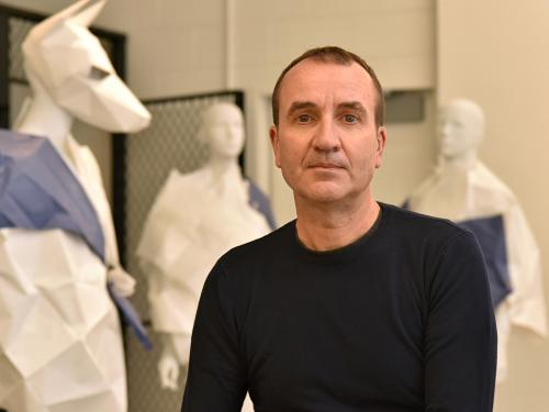 Juan Perdiguero surrounded by creations in his art studio