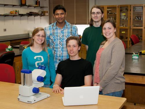 5 original Possibility Scholars in a lab