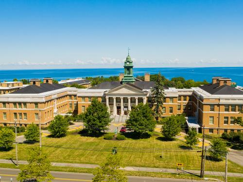 Aerial view of Sheldon Hall in front of Lake Ontario
