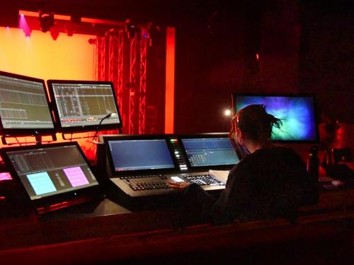 Alaina Herman, a sophomore theatre technology major, controlling the stage lighting during a test run of Going Mad in Wonderland