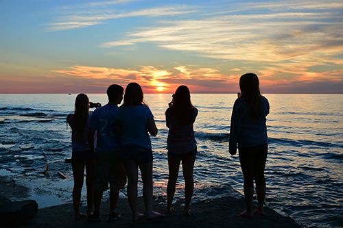 students and sunset on Lake Ontario