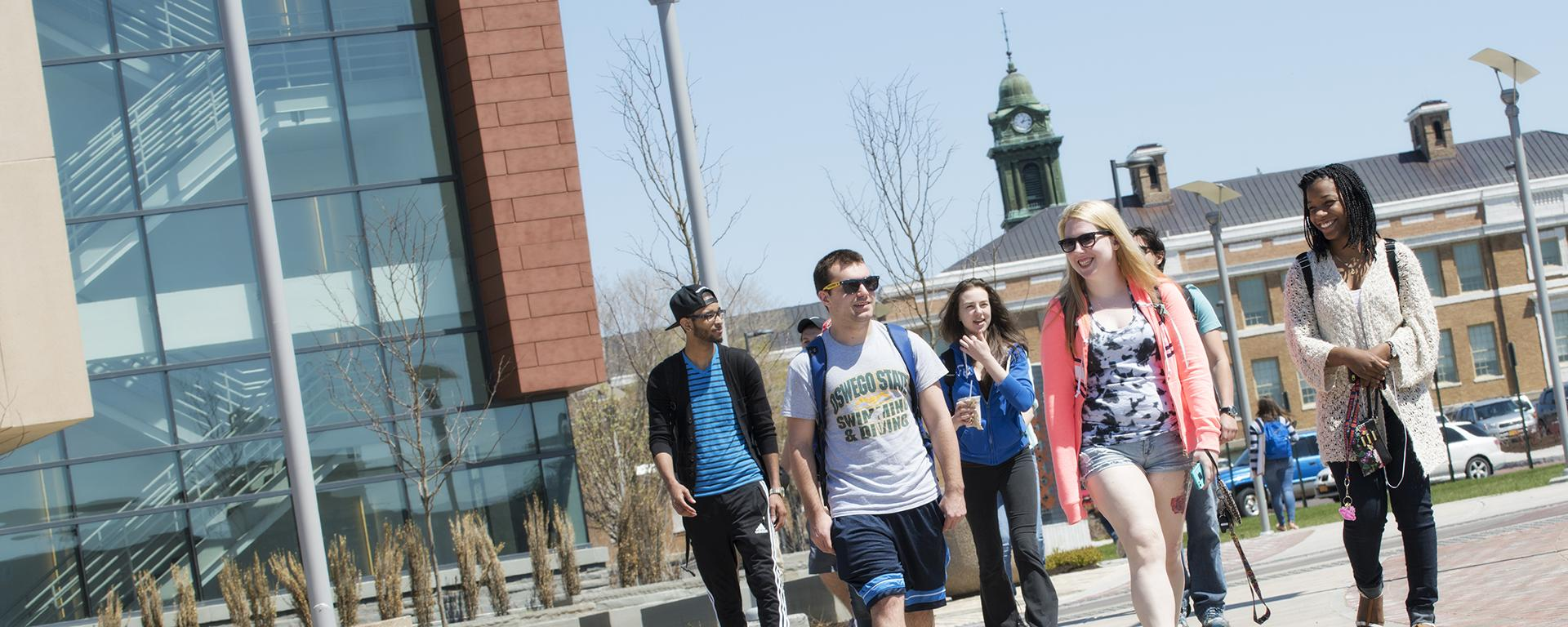 Group of students walks outside the Marano Campus Center