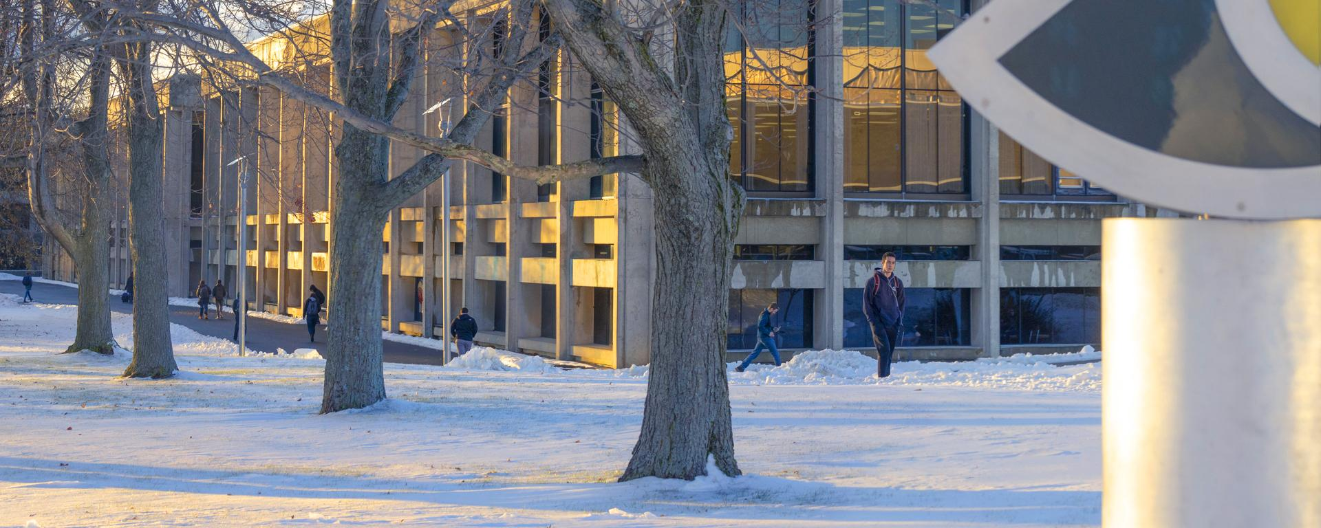 Snow-covered campus with students walking